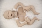 Alex  (asleep) Silicone doll Kit Caucasian Skin tone, unpainted silicone parts.